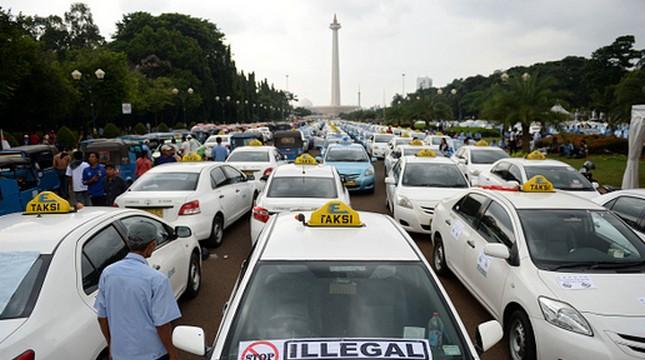 Ilustrasi taksi. (Dimas Ardian/Bloomberg)