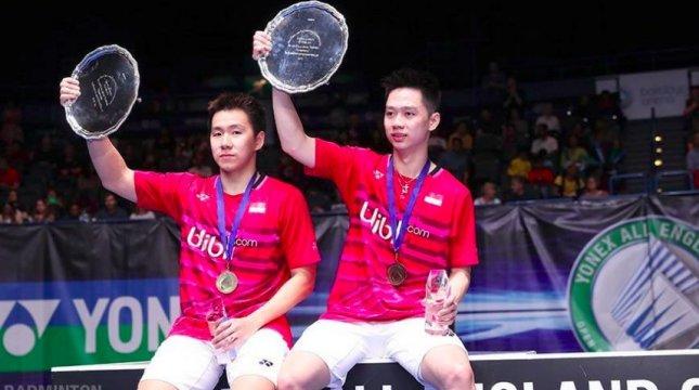 Pasangan ganda putra Indonesia Marcus Fernaldi Gideon/Kevin Sanjaya Sukamuljo merayakan kemenangan mereka di All England. (Foto: IST)
