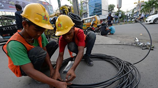 Ilustrasi PLN. (Dimas Ardian/Bloomberg via Getty Images)