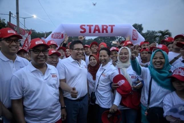 Menteri BUMN Rini Soemarno didamping Dirut PT Telkom Alex J Sinaga (Foto Humas)