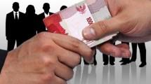 Ilustrasi Uang Suap (jawapos.com)