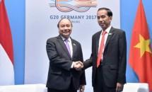 Presiden Jokowi dan PM Vietnam Nguyen Xuan Phuc di KTT G20 (Foto Setkab)
