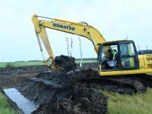 Escavator di lahan rawa