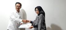 Farida Mokodompit yang semula sebagai Direktur Operasional sekaligus Plt Direkur Utama menjadi definitif Direktur Utama Perum Perindo